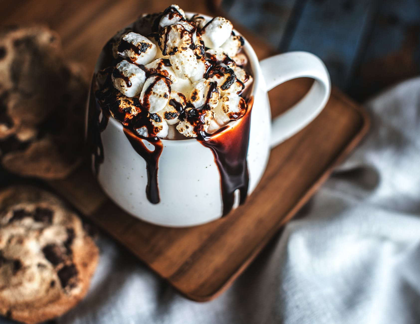 white ceramic mug filled with dessert